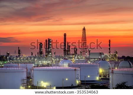 Oil refinery and oil thank in sunset background - stock photo