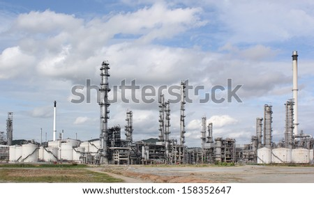 Oil refinery at day time - stock photo