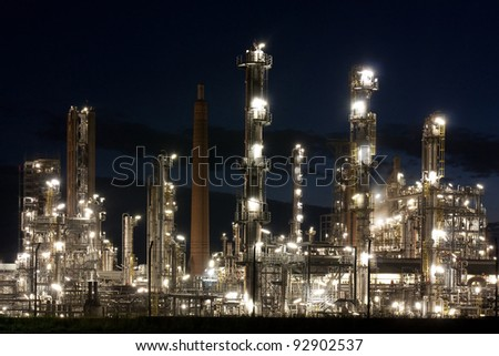 Oil refinery at night in Schleswig-Holstein, Germany. - stock photo