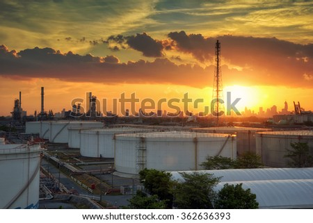 Oil refinery at sunset - factory - petrochemical plant - stock photo