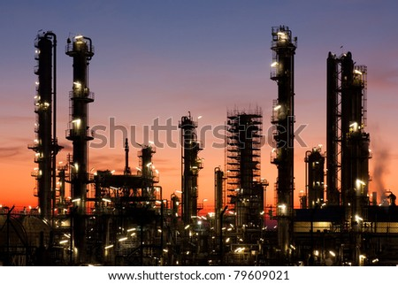 Oil refinery at sunset, petrochemical industry - stock photo