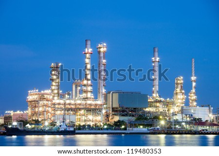 Oil refinery at twilight - factory - stock photo