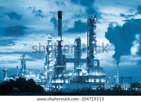 Oil refinery at twilight with blue color tone. - stock photo