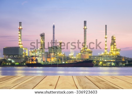 Oil refinery at twilight with wood floor. - stock photo
