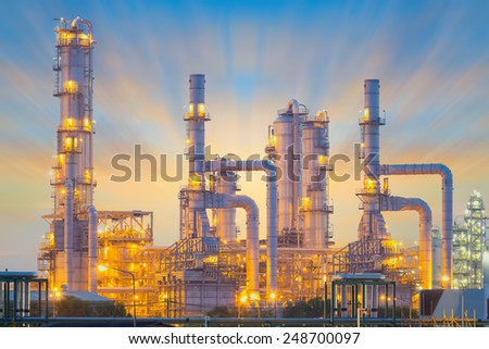 Oil refinery factory at twilight. - stock photo