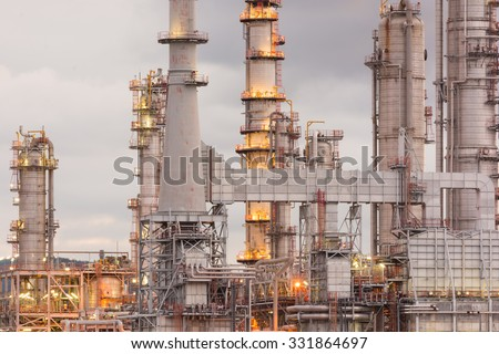 Oil Refinery factory in morning sunrise, Petroleum, petrochemical plant - stock photo