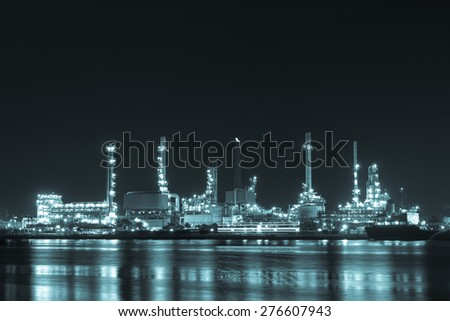 Oil refinery industrial plant at twilight - stock photo