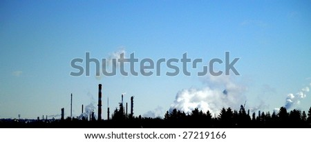 Oil refinery looking east from Edmonton, Alberta across the North Saskatchewan River valley - stock photo