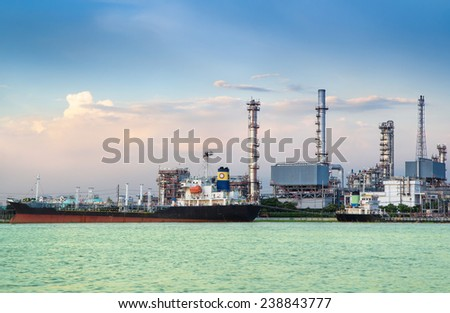 Oil refinery or petrochemical industry with ship in thailand.  for Logistic Import Export background - stock photo