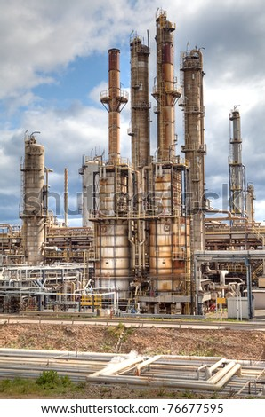 oil refinery petrochemical  chemical industry fuel distillation of petrol global warming industrial architecture - stock photo