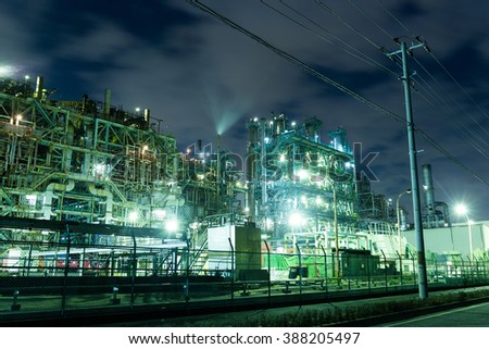 Oil refinery petrochemical industrial at night - stock photo