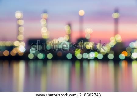 Oil refinery plant area at twilight, Blurred Photo bokeh - stock photo