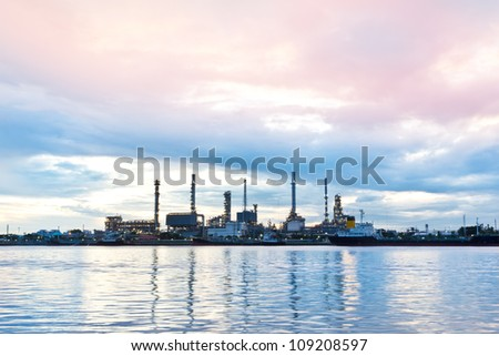 Oil refinery plant at twilight morning along river in Bangkok - stock photo