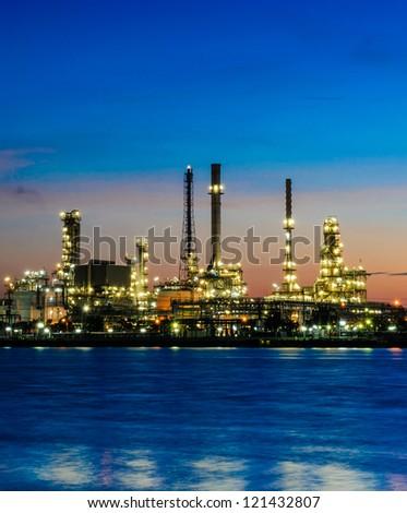 Oil refinery plant at twilight morning along river in Bangkok - stock photo