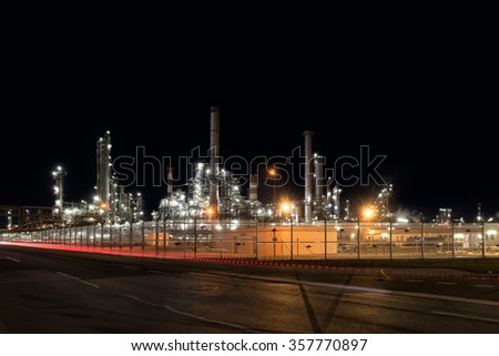 Oil refinery plant of petroleum or petrochemical industry production at night - stock photo