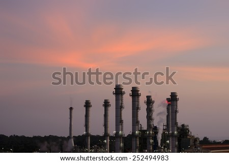 Oil Refinery reflected light water sunset industry in thailand. - stock photo