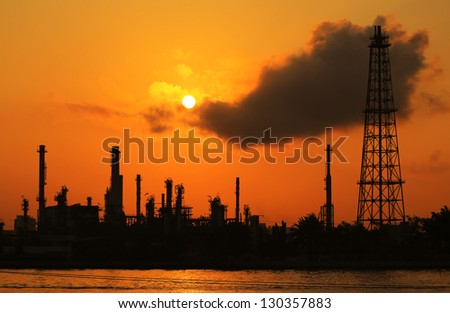 Oil refinery silhouette at sunrisee - stock photo