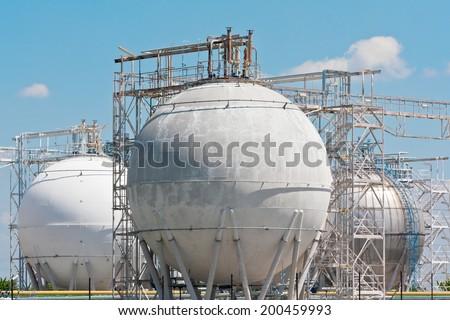 oil refinery storage tanks - stock photo