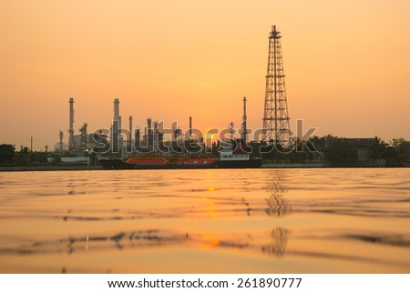 Oil refinery with chemical tanker - stock photo