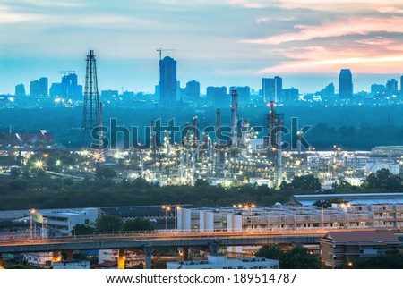 Oil refinery with sunset background - stock photo