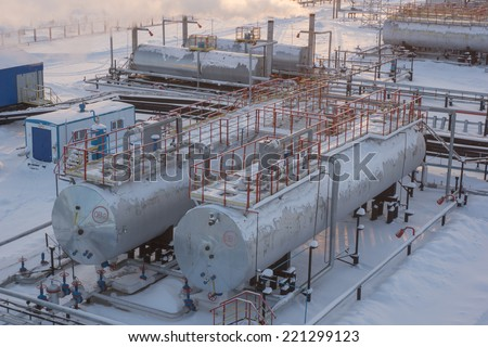 Oil reservoir in the winter - stock photo