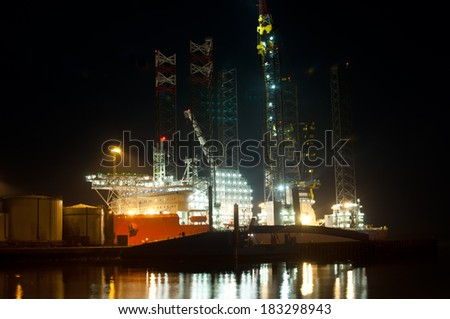 Oil rig at night - stock photo