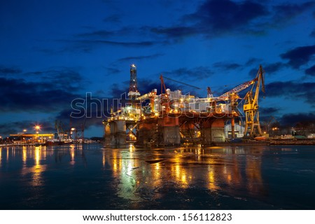 Oil rig at night in winter scenery.  - stock photo