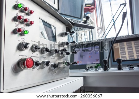 Oil rig controls & switches in operators room on rig floor. - stock photo