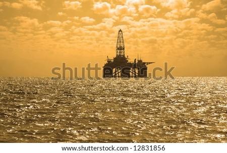 Oil rig during sunset in Baku, Azerbaijan in Caspian Sea - stock photo