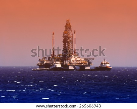 oil rig in gulf of mexico, dramatic skies - stock photo