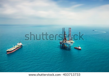 Oil rig in the gulf - stock photo