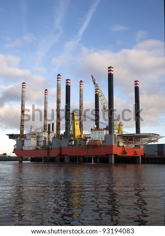 oil rig in the harbor - stock photo