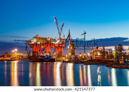 Oil Rig in the shipyard for maintenance at night. - stock photo