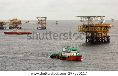 Oil rigs and transportation vessels in the South China Sea - stock photo