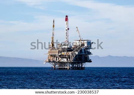 Oil rigs in front of the Ventura coast. - stock photo