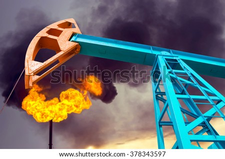 Oil rocking chair on the torch and the cloudy sky background - stock photo