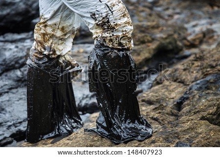 Oil spill on the beach Ao Prao Beach, Koh Samet, Rayong, Thailand - stock photo