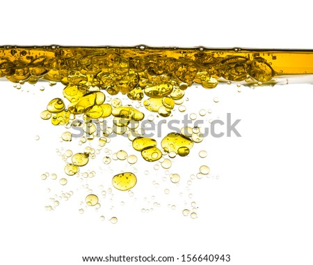 oil splash in water isolated on white background - stock photo
