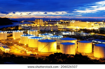 oil tank in power station , sunset  - stock photo