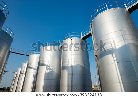 Oil tank in the refinery - stock photo