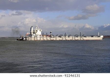 oil tanker and pilot boat assist coming in the harbor of rotterdam netherlands - stock photo