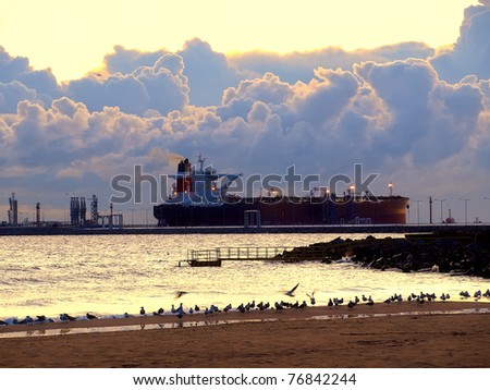 Oil tanker at an offshore terminal. - stock photo