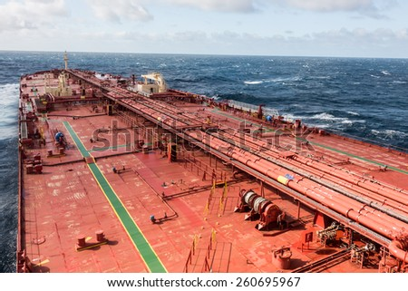 Oil tanker deck in open sea, while stormy weather - stock photo. - stock photo