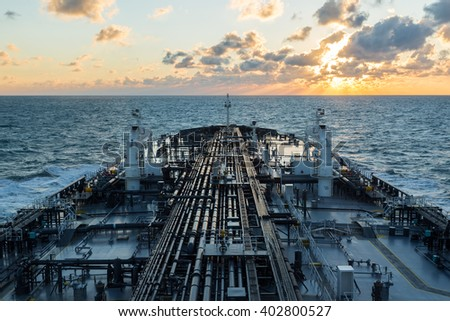 Oil tanker forward part under sunset sky. - stock photo