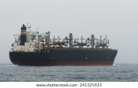 Oil tanker in the middle of the ocean - stock photo