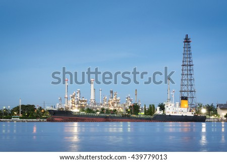 Oil tanker loading at Oil refinery - stock photo