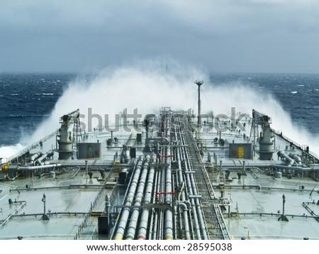 oil tanker ship on open rough sea - stock photo
