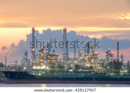 Oil tankers In front of a refinery - stock photo