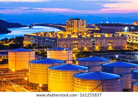 Oil tanks at night - stock photo