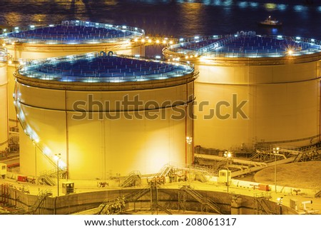 Oil tanks at night in Hong Kong - stock photo
